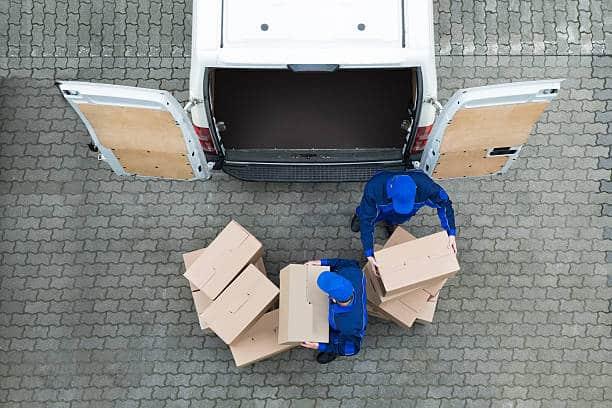 delivery men unloading cardboard boxes